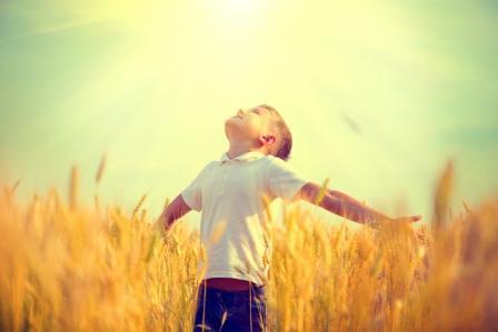 bigstock-Little-boy-on-a-wheat-field-in-95844812
